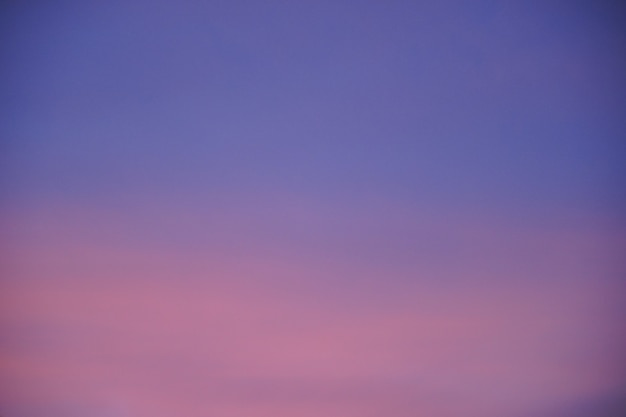 Abstract blurred pink purple and blue gradient colorful clouds and sky sunset on evening nature