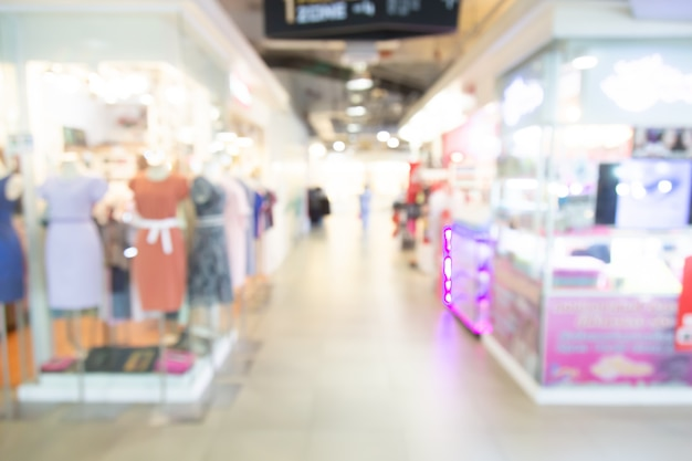 Abstract blurred shopping mall of department store with people background