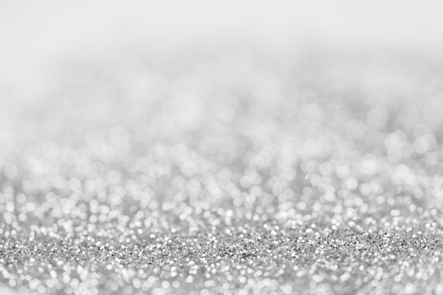 Abstract blurred sparkling silver bokeh background. festive decoration design concept