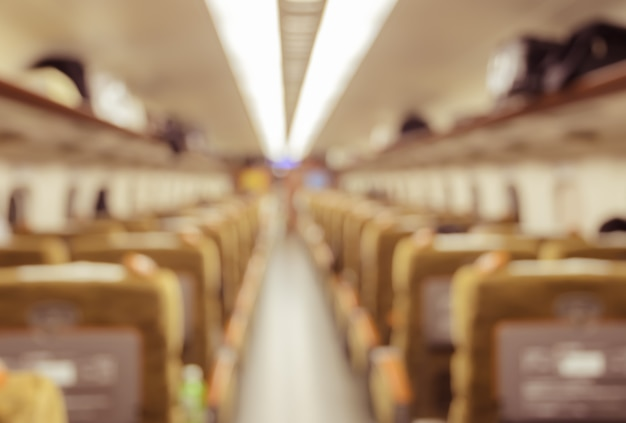 Abstract blurred train interior of a passenger car background.