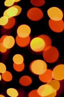 Abstract blurred vibrant yellow and orange color illuminated light on dark background