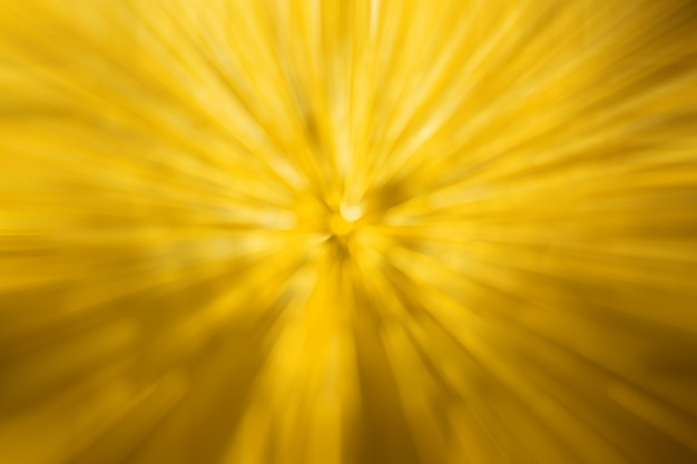 Abstract blurred yellow light by radial effect from water drop at the windscreen bokeh background