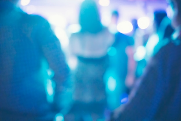 Abstract blurry background, drinkers are dancing in a pub party.