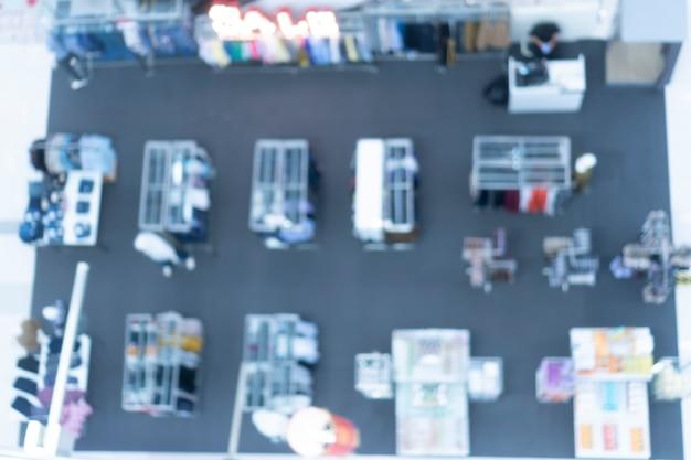 スーパーマーケットの抽象的なぼやけた壁、スーパーストロー、モダンなスーパーマーケットで売買の概念