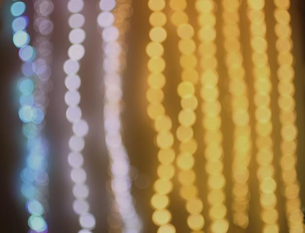 Абстрактный фон боке. расфокусированные праздничные гирлянды. слой наложения. концепция праздника.