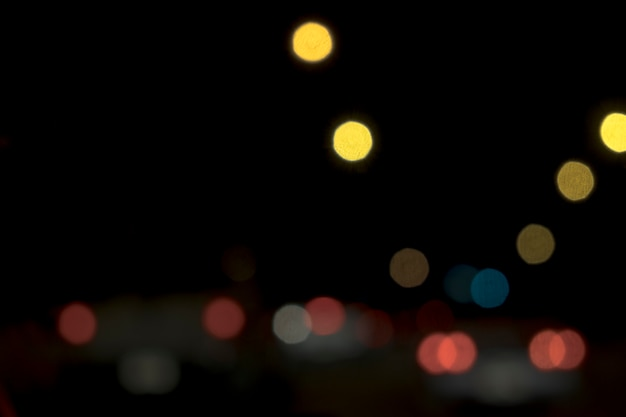 Abstract bokeh blur lights night in the street city background.
