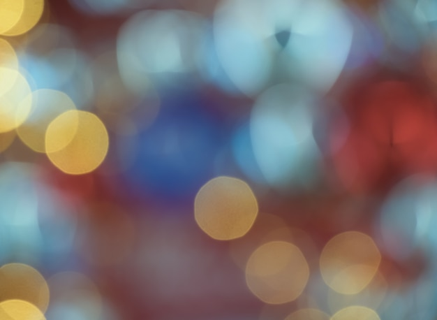 Abstract bokeh colorful light celebration background with de- focused lights