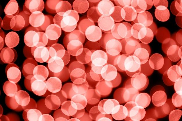 抽象的なボケ珊瑚クリスマスライトの背景お祭りのコンセプトデザインの場所