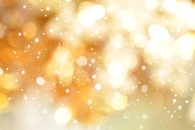 Abstract bokeh gold background with snow