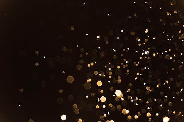 Abstract bokeh of light on black background, christmas and new year concept
