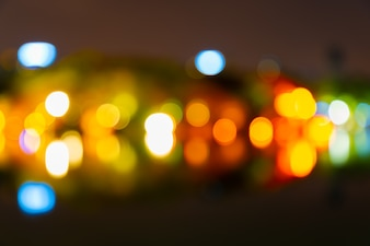 Abstract bokeh of Green, yellow, red, blue on street lights.