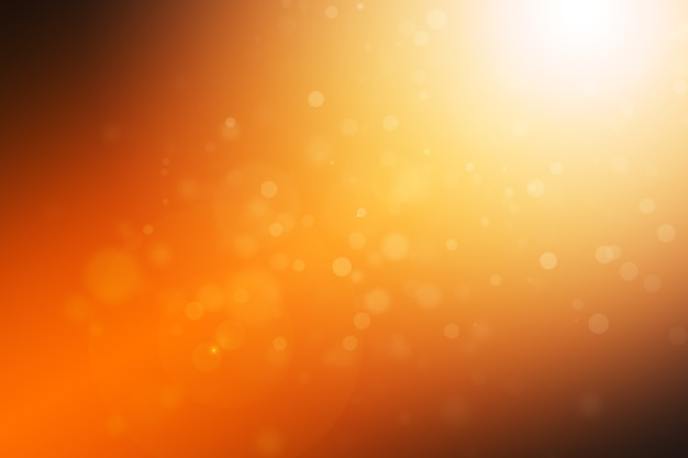 抽象的なbokehオレンジ勾配とフレア光