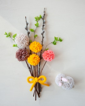 Abstract bouquets and easter bunny made of colorful pom poms