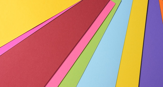 Abstract bright background from multicolored paper, backdrop for designer, copy space