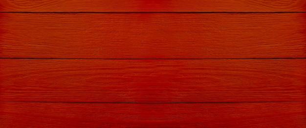 あなたの休日の広告のための抽象的な明るい赤の背景。木の質感。上面図。コピースペース付きのバナー。