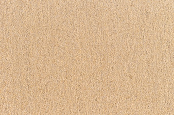 Abstract bright sand texture on the beach for background
