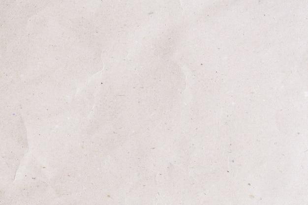 バックグラウンドのための抽象的な茶色のリサイクルのくぼんだ紙