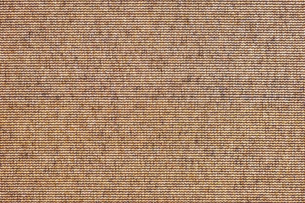Абстрактная коричневая текстура предпосылки. поверхность шероховатой ткани холста как фон