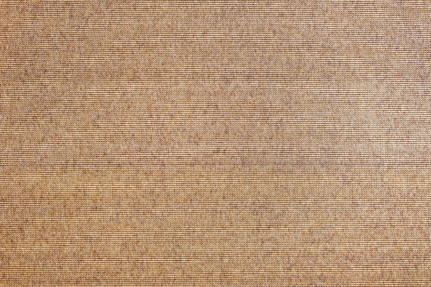 Abstract brown texture background. surface of rough sack cloth canvas as backdrop for design.