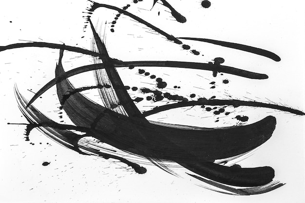 Abstract brush strokes and splashes of paint on white paper