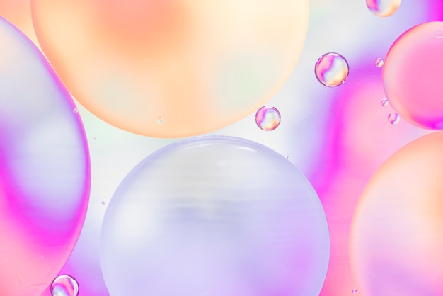 Abstract bubbles on hued blurred background