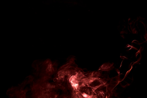 The abstract burning bright smoke on a black background