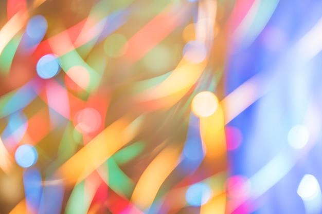 다채로운 bokeh 모션의 추상 burred 질감 배경입니다. 작은 네온 불빛의 긴 노출