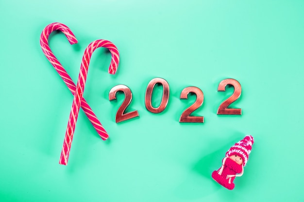 Abstract card,happy new years 2022 - metal number with golden glitter.close up of coming year numbers.new year celebration and festive background.product for holiday promotion and advertise