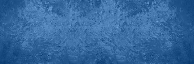 セメントコンクリート背景を抽象化します。グランジテクスチャ、壁紙。落ち着いたカラーの落ち着いたカラーのモノトーンブルー。トップビュー、コピースペース。
