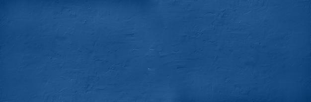 セメントコンクリート背景を抽象化します。グランジテクスチャ、壁紙。落ち着いたカラーの落ち着いたカラーのモノトーンブルー。