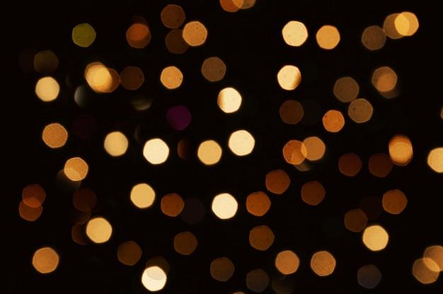 밝은 반짝이 조명 bokeh 검은 배경으로 추상 크리스마스 배경