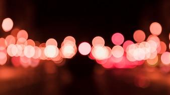 夜の抽象的な円形のボケの背景