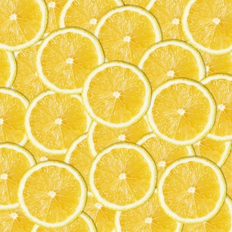 抽象的な柑橘類の背景黄色のレモンスライスのシームレスなパターン