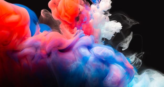 抽象的なカラーミックス、水に落ちるインクカラーミックスペイントのドロップ水中のカラフルなインク、水中のカラードロップ