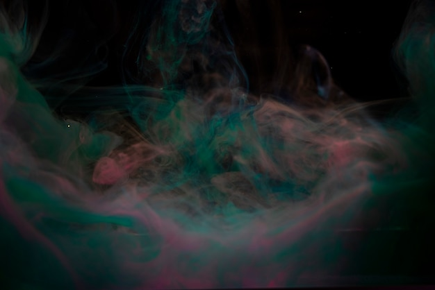 Abstract color paint splash isolated on black background
