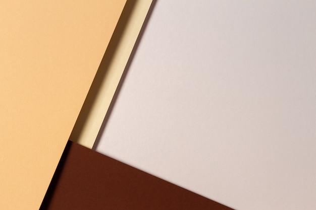 Абстрактная цветная бумага, геометрия, плоская планировка, фон с коричнево-желтыми бежевыми тонами