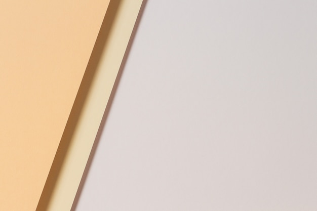 Abstract color papers geometry flat lay composition background with light brown beige color tones