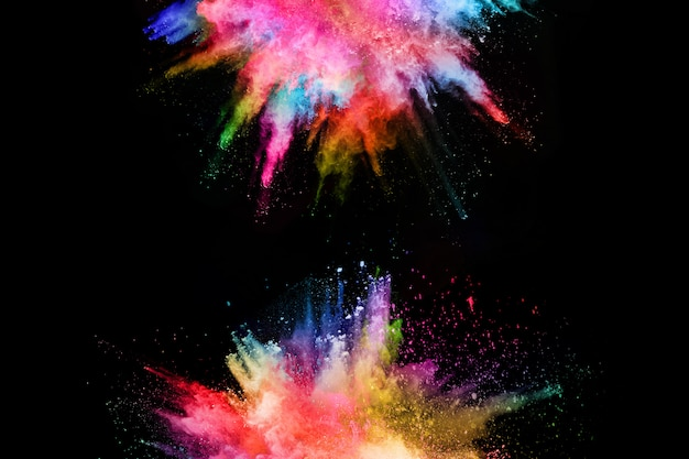 Abstract colored dust explosion on a black background.abstract powder splatted background