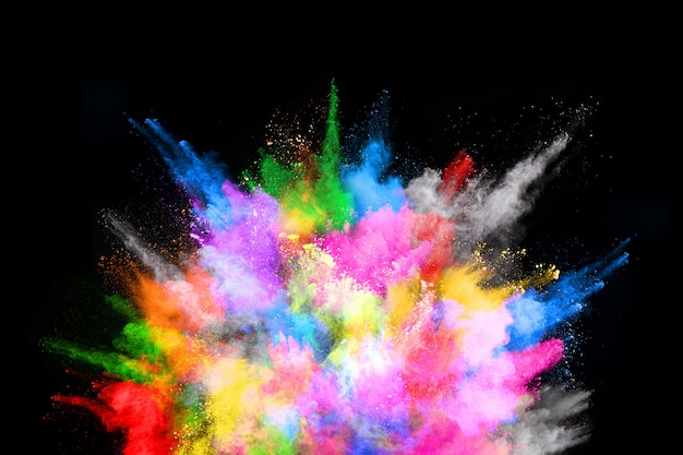 Abstract colored dust explosion on  black background.abstract powder splatted background.