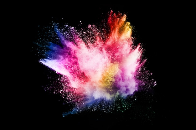 Abstract colored dust explosion on a black background.