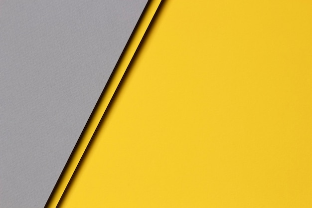 Abstract colored paper texture wall. minimal geometric shapes and lines in yellow and gray colors.