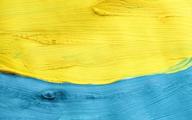 Абстрактный красочный фон, нарисованный красками синего и желтого цветов ручной работы