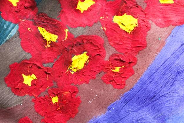 Абстрактный красочный фон, нарисованный красками красный и желтый ручной работы фон