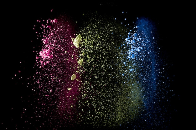 추상 화려한 먼지 입자 질감 배경. 검은 배경에 여러 가지 빛깔 된 분말 폭발입니다.