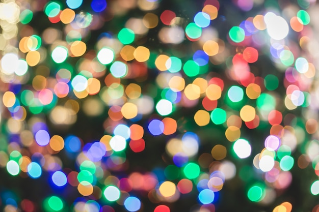 Abstract colorful multicolor bokeh circles for christmas light background.