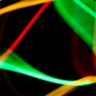 Abstract colorful neon tubes on black background