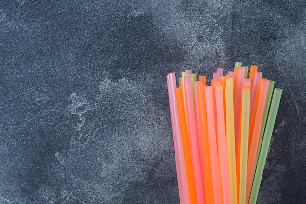 Abstract a colorful of plastic straws used for drinking water or soft drinks. selective focus. copy space