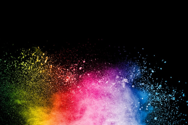 Abstract colorful powder explosion on black