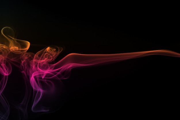 Abstract colorful smoke pattern on black background