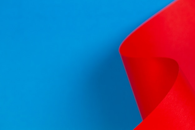Abstract colorful wall with red blue color paper in geometric shapes. selective focus